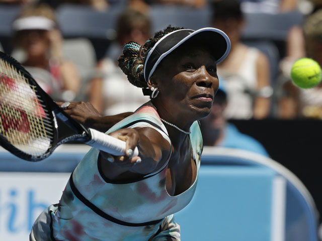 American Venus Williams returns a shot during her first round victory at the Australian Open tennis championship on January 14, 2013