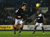 Millwall's John Marquis heads home the winner against Aston Villa on January 25, 2013