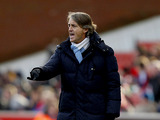 Manchester City boss Roberto Mancini on the touchline during the FA Cup fourth round match against Stoke on January 26, 2013