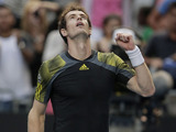 Britain's Andy Murray celebrates after defeating Gilles Simon in the fourth round of the Australian Open tennis championship on January 21, 2013