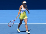 Caroline Wozniacki argues over a line call with the chair umpire during her fourth round clash at the Australian Open tennis championship on January 21, 2013