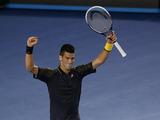 Serbia's Novak Djokovic celebrates defeating David Ferrer in their semifinal match at the Australian Open tennis championship on January 24, 2013