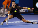 Serbia's Novak Djokovic in action against Andy Murray during their men's final at the Australian Open tennis championship on January 27, 2013