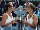 Italians Sara Errani (right) and Roberta Vinci (left) celebrate winning the women's doubles final in the Australian Open tennis championship on January 25, 2013