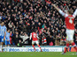 Arsenal player Oliver Giroud celebrates scoring his second goal in his sides match with Brighton and Hove Albion on January 26, 2013