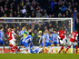 Arsenal's Theo Walcott scores his teams third goal in their FA Cup fourth round match on January 26, 2013