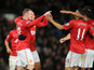 Manchester United forward Wayne Rooney celebrates with teammates after scoring his sides second goal in their FA Cup fourth round match with Fulham on January 26, 2013