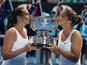 Italians Sara Errani (right) and Roberta Vinci (left) celebrate winning the women's doubles final in the Australian Open tennis championship on January 25, 2013
