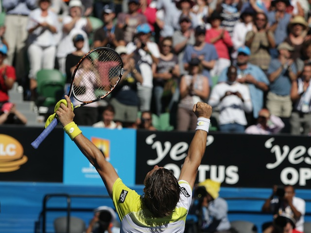 Spaniard David Ferrer celebrates his quarter-final victory over Nicolas Almagro on January 22, 2013