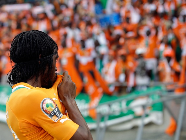 Ivorian Gervinho kisses the badge on his shirt after scoring the winning goal against Togo on January 22, 2013
