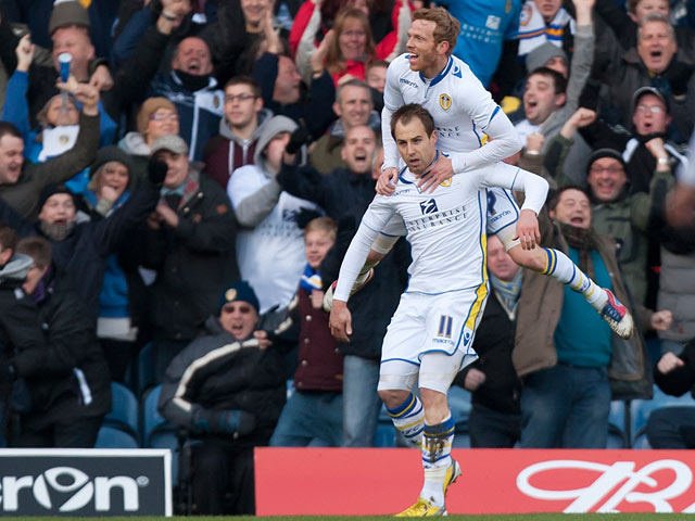 Luke Varney is congratuated by Paul Green in front of their fans after scoring the opening goal in the FA Cup fourth round tie against Tottenham on January 27, 2013