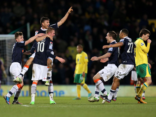 Luton player Scott Rendall celebrates with teammates after scoring his sides goal in their FA Cup fourth round match against Norwich on January 26, 2013