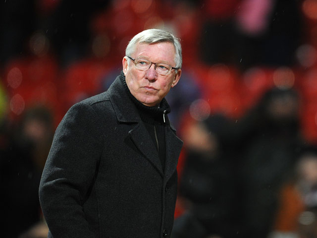 Manchester United manager Sir Alex Ferguson leaves the pitch after his sides win over Fulham on January 26, 2013