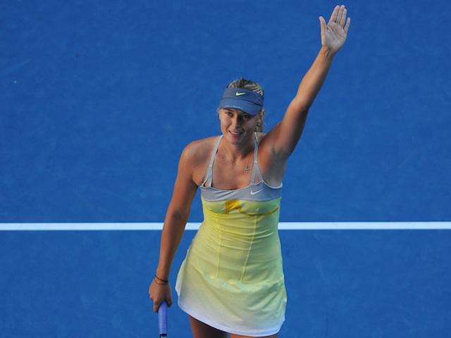 Maria Sharapova waves to the crowd following her quarter-final victory over Ekaterina Makarova on January 22, 2013