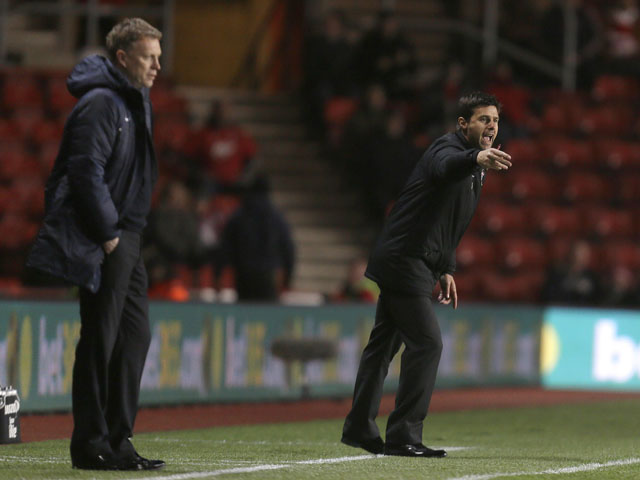 New Southampton manager Mauricio Pochettino (right) and his opposite number David Moyes (left) watch their team's match on January 21, 2013