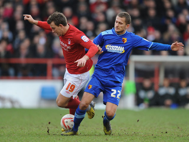 Nottingham Forest's Simon Cox is fouled by Watford player Almen Abdi in their Championship match on January 26, 2013