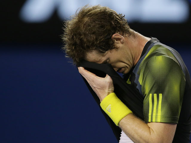 Britain's Andy Murray wipes sweat from his forehead during the men's final of the Australian Open tennis championship on January 26, 2013