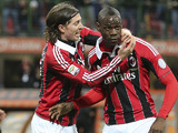AC Milan forward Mario Balotelli celebrates with a teammate after scoring on his debut on February 3, 2013