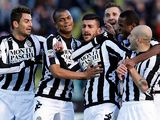 Siena's Alessio Sestu is congratulated by team mates after scoring his team's second against Inter on February 3, 2013