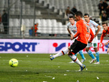 Lorient forward Jeremie Aliadiere scores a penalty in his team's game with Marseille on December 9, 2012