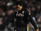 New Fulham signing Urby Emanuelson warms up before the game against Man Utd on February 2, 2013