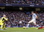 Manchester City forward Edin Dzeko scores the first goal of his side's match with Liverpool on February 3, 2013
