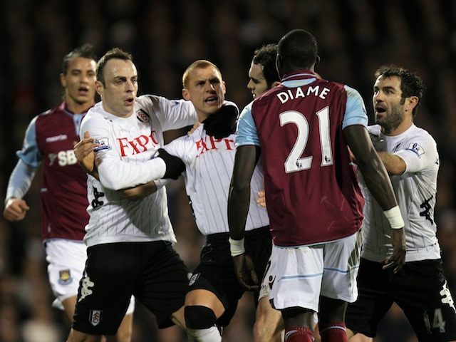Fulham's Dimitar Berbatov clashes with West Ham midfielder Mo Diame on January 30, 2013