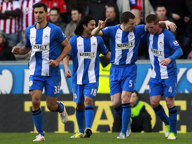 Wigan players congratulate Gary Caldwell after his opener against Southampton on February 2, 2013