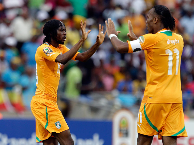 Gervinho and Didier Drogba celebrates their team's equaliser against Nigeria on February 3, 2013