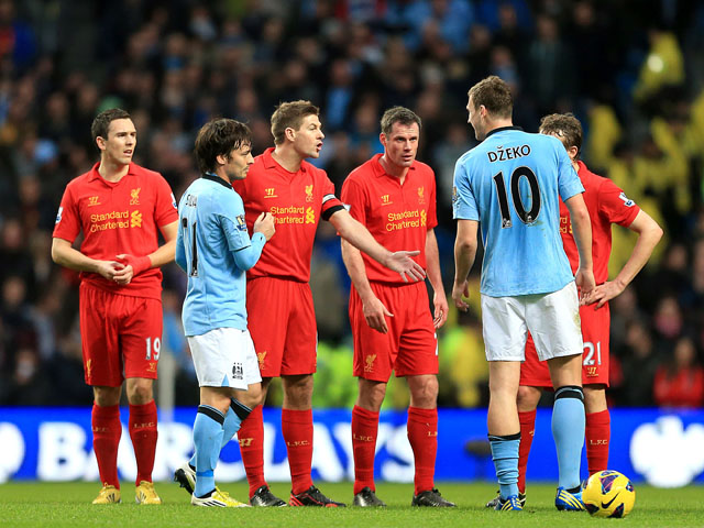 Liverpool captain Steven Gerrard and Manchester City froward Edin Dzeko exchange words following Liverpool's goal in the team's clash on February 3, 2013