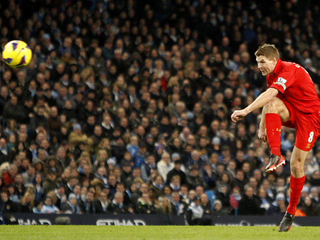 Liverpool captain Steven Gerrard scores his side's second goal against Manchester City on February 3, 2013