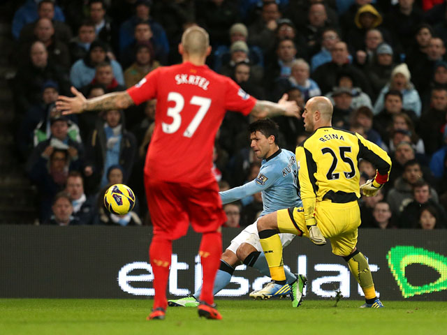 Manchester City striker Sergio Aguero scores his team's second goal on February 3, 2013