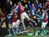 Charles N'Zogbia is mobbed by team mates after scoring his team's second against West Ham on February 10, 2013