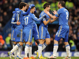 Chelsea players congratulate Eden Hazard after he scored his team's second goal against Wigan on February 9, 2013