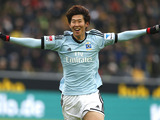 Hamburg's Son Heung-min celebrates after scoring in his side's match against Dortmund on February 9, 20