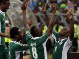 Nigeria players celebrate after a goal in their African Cup of Nations match with Mali on February 6, 2013