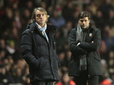 Manchester City manager Roberto Mancini and Southampton manager Mauricio Pochettino watch their side's in action on February 9, 2013