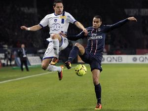 Paris Saint Germain's defender Gregory Van Der Wiel challenges for the ball on February 8, 2013