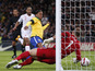 England's Joe Hart saves the ball after Brazil's Ronaldinho follows up his missed penalty in their side's match on February 6, 2013
