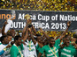 Nigeria players hold up the trophy after defeating Burkina Faso in the final of the African Cup of Nations on February 10, 2013