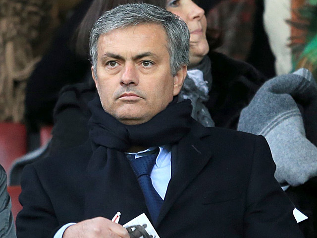 Real Madrid boss Jose Mourinho in the stands at Old Trafford to watch his team's Champions League opponents Manchester United play against Everton on February 10, 2013