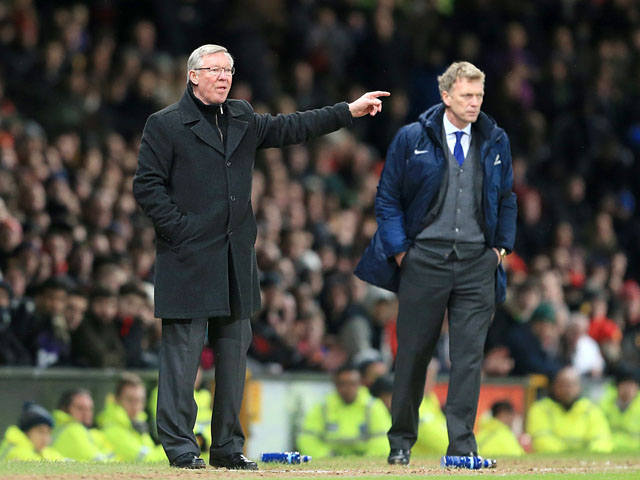Manchester United manager Sir Alex Ferguson and Everton manager David Moyes watch their side's in action on February 10, 2013