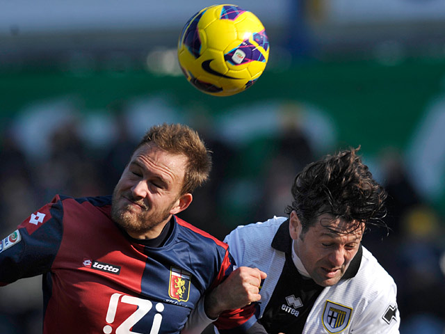 Parma's Massimo Gobbi and Genoa's Andreas Granqvist battle for the ball on February 10, 2013