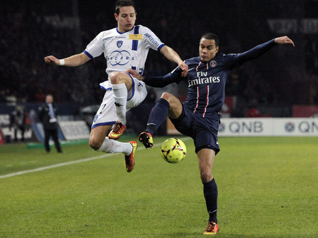 Paris Saint Germain's defender Gregory Van Der Wiel challenges for the ball on February 8, 2013