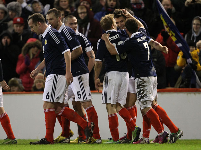 Scotland players celebrate following Charlie Mulgrew's goal in their match against Estonia on February 6, 2013