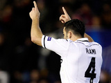 Valencia's Adil Rami celebrates his late goal against Paris Saint-Germain on February 12, 2013