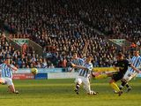 Wigan's Callum McManaman scores the opener during the FA Cup 5th round against Huddersfield on February 17, 2013