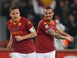 Roma's Francesco Totti celebrates with team mate Pablo Osvaldo after scoring the opener against Juventus on February 16, 2013