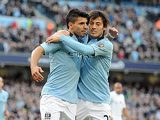Manchester City's Sergio Aguero is congratulated by David Silva after scoring a penalty against Leeds in the FA Cup 5th round on February 17, 2013