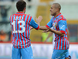 Catania's Sergio Almiron is congratulated by team mate Mariano Izco after scoring the opener against Bologna on February 17, 2013